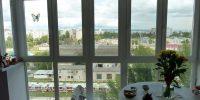 Совмещенный балкон с теплыми панорамными окнами